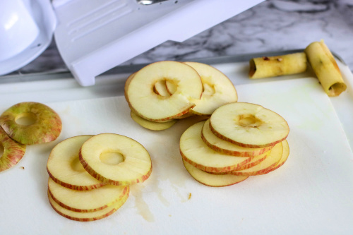 Air Fryer Homemade Apple Chips- Try these tasty homemade air fryer apple chips and you will have a new favorite snack. They are kid-friendly and super easy to make! | #airFryer #recipe #homemadeSnacks #appleChips #ACultivatedNest
