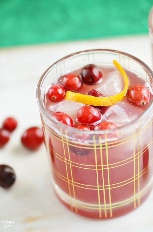 Cranberry Pineapple Mocktail Recipe- This is the ultimate list of easy and delicious Christmas drink recipes. Serve them at your next holiday party and everyone will rave about them for sure! | holiday drink recipes, nonalcoholic drinks, kid friendly drinks, hot drinks, cold drinks, #recipe #drinks #ChristmasDrinks #alcoholicDrinks #ACultivatedNest
