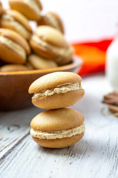 Easy Pumpkin Cheesecake Sandwich Cookies- These mini pumpkin cheesecake sandwich cookies are just the perfect snacking size! One isn't going to be enough and with one taste, you'll see why! | fall dessert recipes, autumn treat recipes, #recipe #pumpkin #dessert #cookies #ACultivatedNest