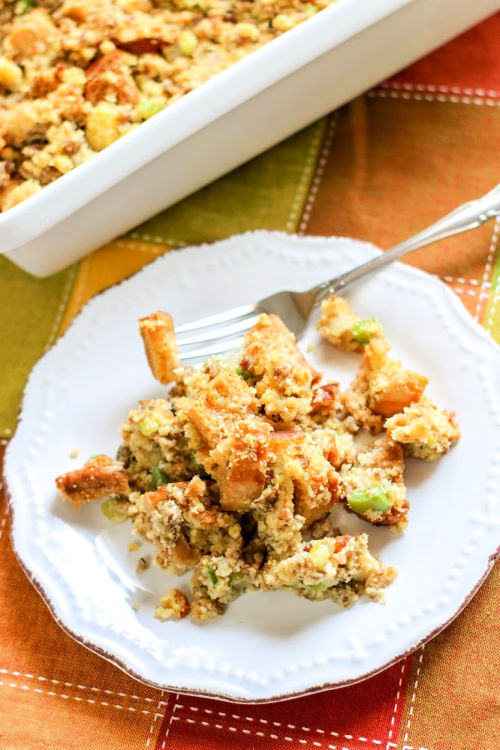 Sausage and Cornbread Stuffing from Scratch- Enjoy some comforting and delicious cornbread and sausage stuffing for the holidays this year! It's easy to please a crowd with homemade stuffing! | #ThanksgivingRecipes #ChristmasRecipes #stuffing #recipe #ACultivatedNest