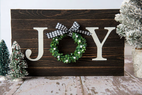 Joy Sign DIY Holiday Decor- This DIY joy sign is beautiful and looks great with all your holiday decorations. Plus, it's very easy and inexpensive to make! | rustic Christmas decor, #DIY #craft #Christmas #holidayDecor #ACultivatedNest