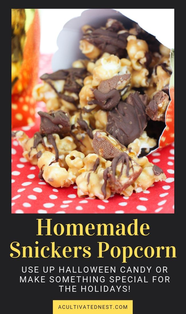 Homemade Snickers Popcorn- If you want something special to serve for your next movie night, you have to make this delicious homemade Snickers popcorn! It also makes a wonderful DIY food gift! | way to use up leftover Halloween Candy, #homemadePopcorn #recipe #chocolate #foodGift #ACultivatedNest
