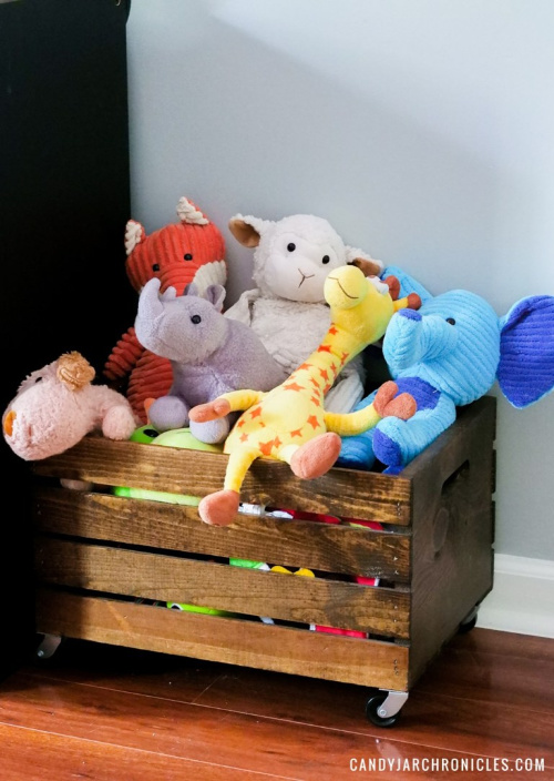 Wooden Crate Toybox- Tired of toys lying everywhere? You and your kids need these creative DIY toy storage ideas! They're easy to implement and look nice too! | kids room organization, kids playroom organization, how to organize kids toys, #toyStorage #toyOrganization #organizingTips #organization #ACultivatedNest