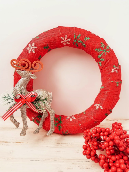 DIY Reindeer Holiday Wreath- Want to decorate for the holidays on a budget? This pretty reindeer wreath dollar store DIY can be made with just a few steps and inexpensive dollar store supplies! | #diyProject #wreath #ChristmasDecor #ChristmasWreath #ACultivatedNest