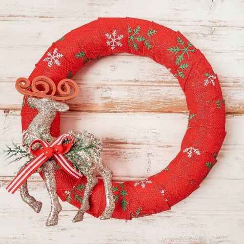 Reindeer Wreath Dollar Store DIY- Want to decorate for the holidays on a budget? This pretty reindeer wreath dollar store DIY can be made with just a few steps and inexpensive dollar store supplies! | #diyProject #wreath #ChristmasDecor #ChristmasWreath #ACultivatedNest