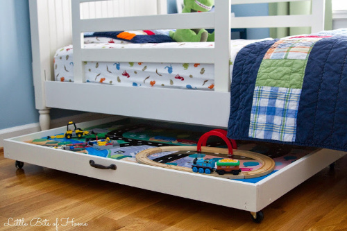 Train Table Storage Idea- Tired of toys lying everywhere? You and your kids need these creative DIY toy storage ideas! They're easy to implement and look nice too! | kids room organization, kids playroom organization, how to organize kids toys, #toyStorage #toyOrganization #organizingTips #organization #ACultivatedNest