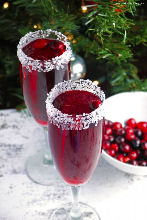 Cranberry Mimosa Recipe- This is the ultimate list of easy and delicious Christmas drink recipes. Serve them at your next holiday party and everyone will rave about them for sure! | holiday drink recipes, nonalcoholic drinks, kid friendly drinks, hot drinks, cold drinks, #recipe #drinks #ChristmasDrinks #alcoholicDrinks #ACultivatedNest