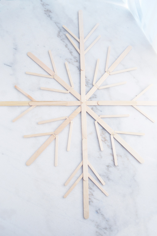 DIY Giant Snowflakes- You can easily make these beautiful fluffy big DIY snowflakes to decorate your tree, mantle, or home. They add a touch of elegance to your space! | Christmas craft, frugal Christmas decorations, #DIY #Christmas #craft #ChristmasDecor #ACultivatedNest