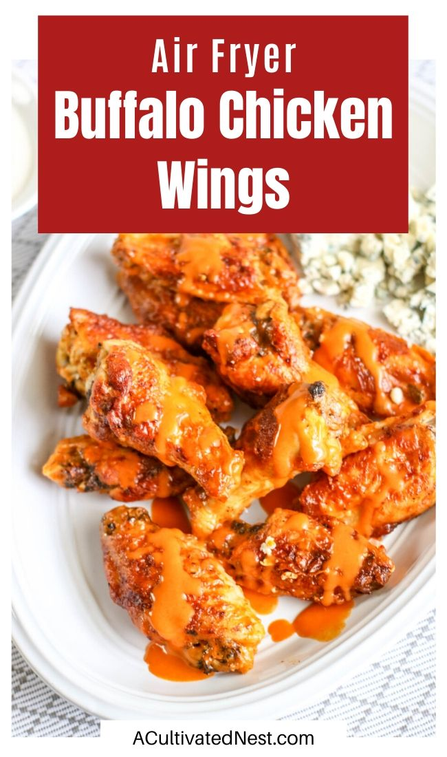 Air Fryer Buffalo Chicken Wings- These air fryer buffalo chicken wings are perfect for big get-togethers! Whether you need a party appetizer or the main meal for a game day watch party, these delicious homemade chicken wings are easy to cook in your air fryer! | #recipe #buffaloWings #airFryer #chicken #ACultivatedNest