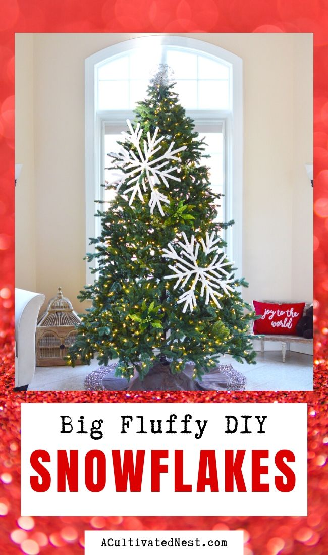 Fluffy Big DIY Snowflakes- If you want a big statement piece to add to your home's Christmas decor, you need to make these beautiful fluffy big DIY snowflakes! They're easy to make and will add a touch of elegance to your space! | Christmas craft, frugal Christmas decorations, #diyProject #ChristmasDIY #craft #Christmas #ACultivatedNest