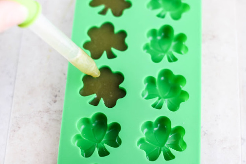 Shamrock Homemade Gummies Recipe- These shamrock fruit juice gummies are a wonderful holiday treat that are easy to make and only take 3 ingredients. Kids and adults love them! | #gummies #SaintPatricksDay #recipe #shamrock #ACultivatedNest