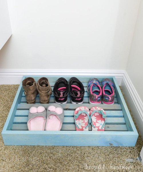 10 Genius Homemade Shoe Storage Solutions- Get rid of the shoe chaos and use these genius DIY shoe storage solutions instead! They're the perfect way to get your shoes organized! | #organization #organizingTips #shoeOrganization #DIY #ACultivatedNest