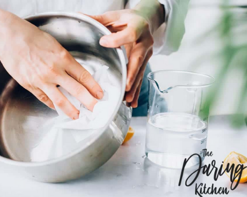 10 Best Pot and Pan Cleaning Hacks- Clean up charred food and burned on grease easily with these 10 cookware cleaning tips! These cookware cleaning hacks will leave your cookware looking brand new! | cleaning copper cookware, cleaning stainless steel cookware, cleaning cast iron pans, #cleaningHacks #cleaningTips #cleaning #kitchenCleaning #ACultivatedNest
