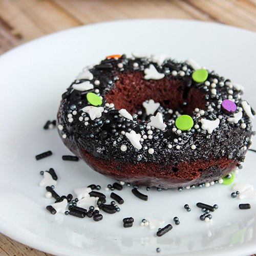 Homemade Chocolate Baked Donuts- Not only are these delicious homemade chocolate baked donuts healthier because they aren't fried, but they're also really easy to make! Add some Halloween sprinkles for the perfect Halloween dessert!   #HalloweenRecipe #HalloweenDessert #donuts #baking #ACultivatedNest